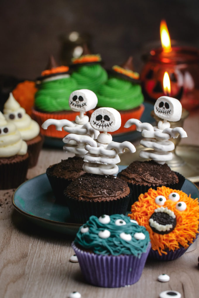 Halloween themed cupcakes. Skeleton cupcakes, monster cupcakes, ghost cupcakes, and witch cupcakes.