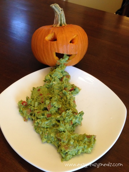 Pumpkin Throwing Up: A fun and creative way to serve guacamole dip with chips at any Halloween part! Is sure to make guests look twice before dipping!