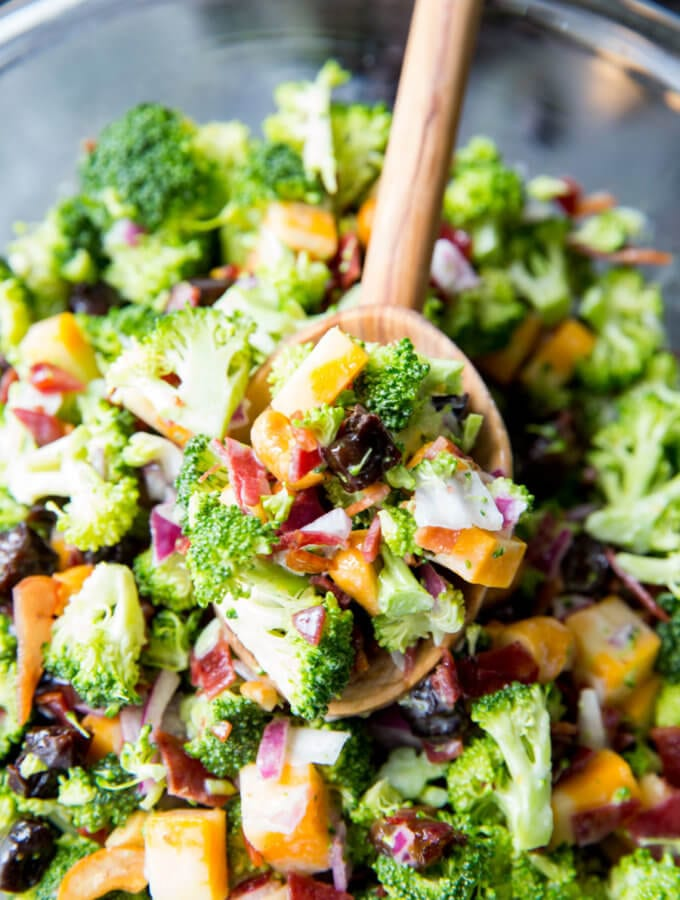 Best Ever Broccoli Salad: Broccoli, cashews, cheese, bacon, red onion, dried fruit and a tangy sauce