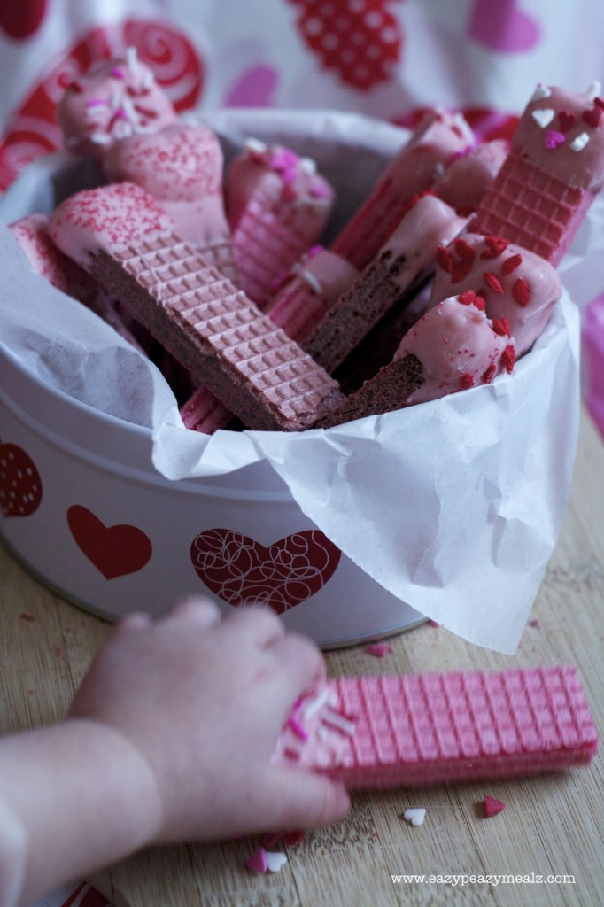 Baby grabbing valentine wafers