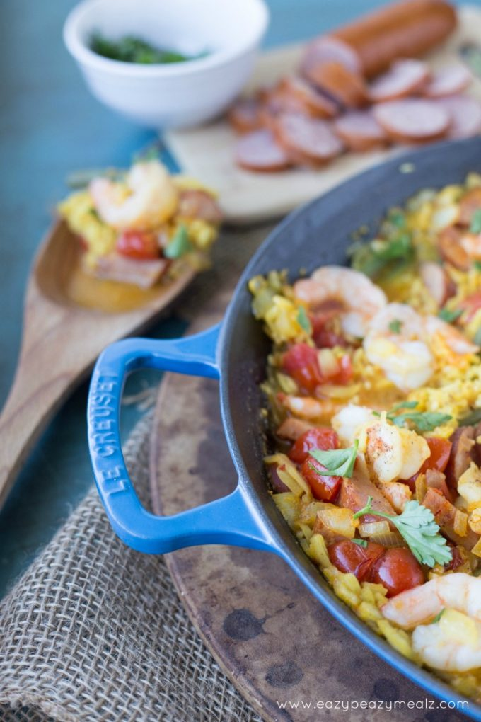 Recipe for Spanish Paella: Saffron infused rice, hearty sausage, prawns, and fresh green beans! This Spanish Paella will take your tastebuds on a Valencian vacation.