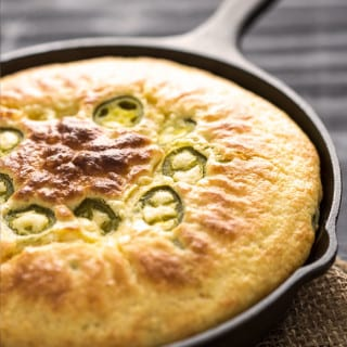 Cheddar Jalapeno Cornbread made using a mix and amped up with extras! This is seriously good stuff, perfect to go along with chili!