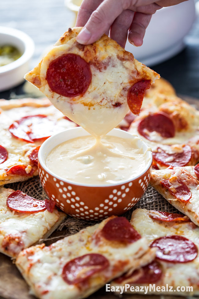 Pizza dipped in a chipotle four cheese nacho sauce that is dang good!