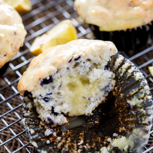 Sour Cream Lemon filled Blueberry Muffins, with sour cream lemon glaze. Utterly delectable.