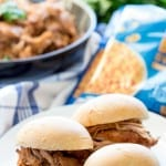 BBQ pork sliders use slow cooker bbq pork sandwiched on fresh rolls