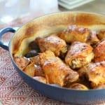 Baked chicken with lemon garlic creamy sauce in skillet