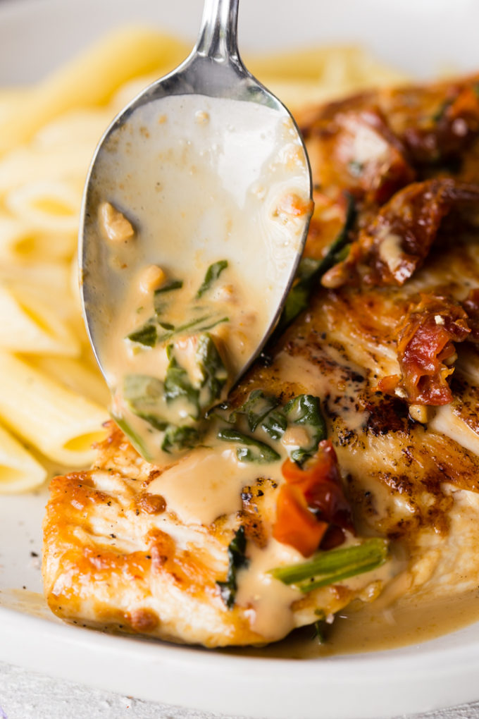 Spooning sauce over seared chicken