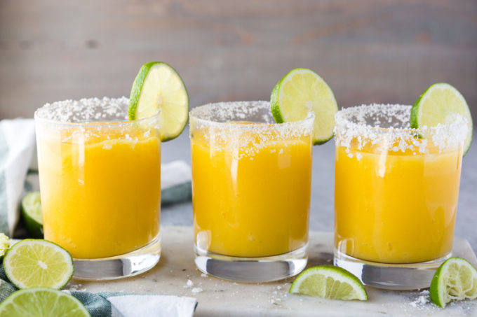 All lined up, frozen mango margaritas