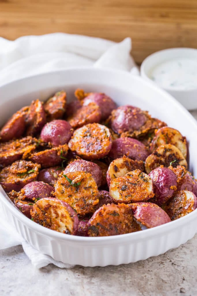 These garlic parmesan roasted potatoes are a delicious side dish or appetizer that you can make in no time. Quick prep time with tons of flavors.