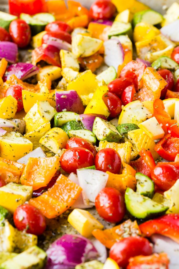 A sheet pan of color vegetables sprinkled with greek seasoning