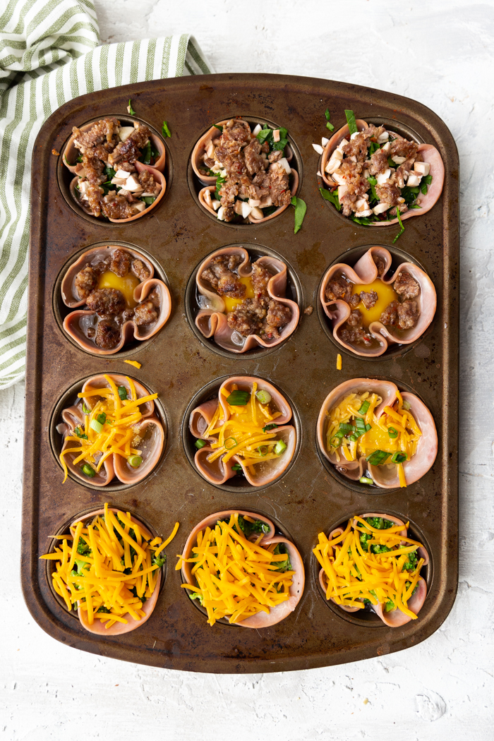 Ham and egg cups with sausage.