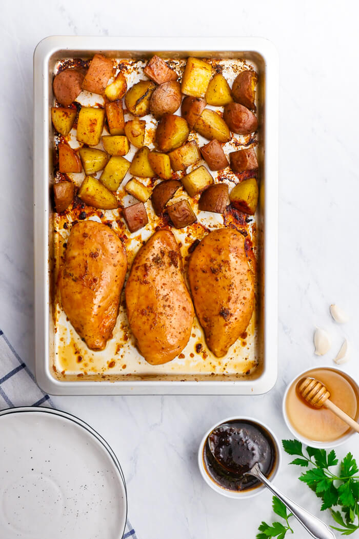 Honey Garlic Chicken and potatoes, cooked on a single sheet pan