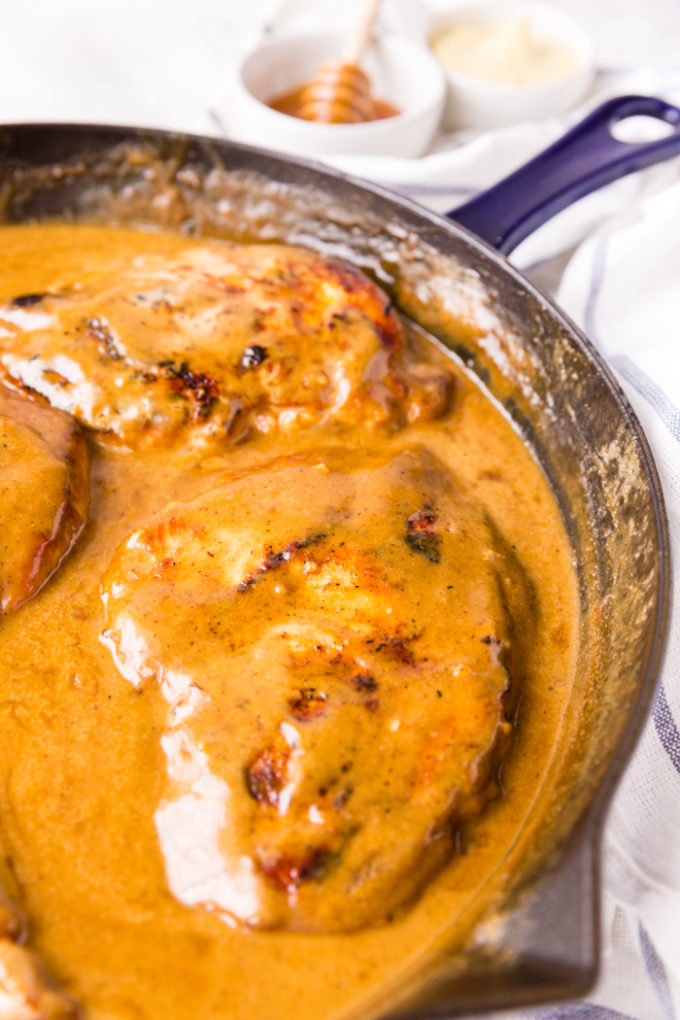 Honey dijon mustard chicken in a skillet