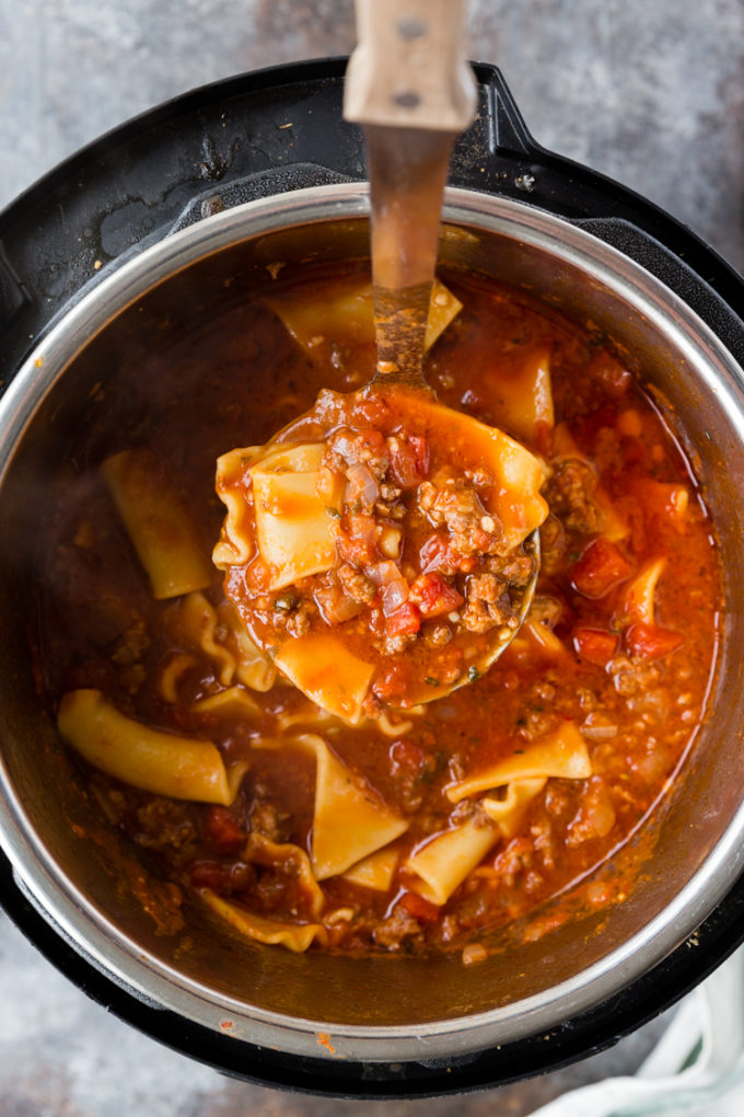 Making instant pot lasagna soup cooked in the pressure cooker