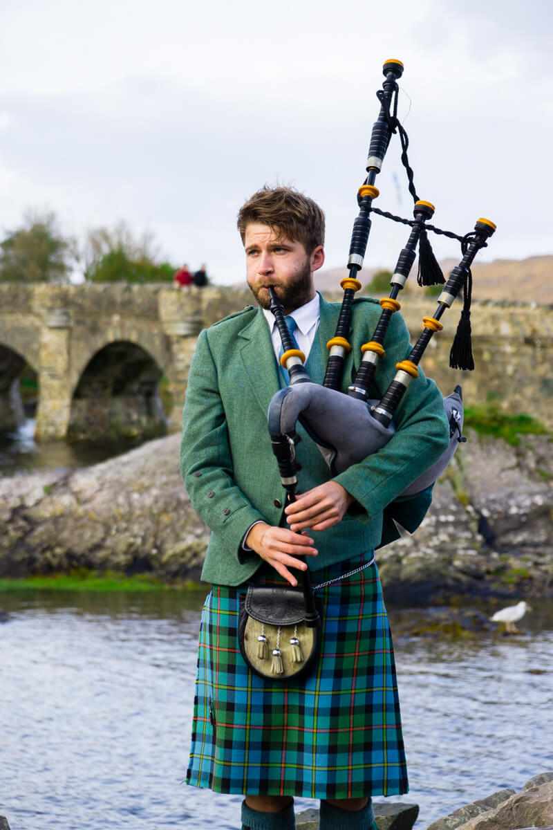 Bag Piper at Eilean Donan Castle in Isle of Skye Scotland
