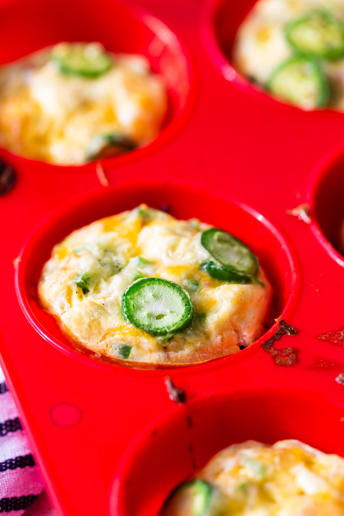 Jalapeno popper egg cups in a silicone baking tin