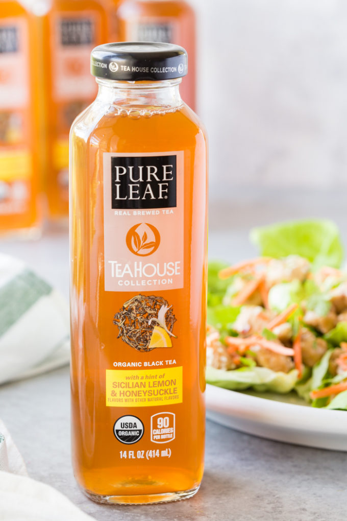A bottle of Tea House Collection Pure Leaf tea with lettuce wraps in the background.