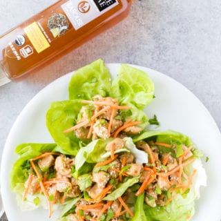 Lemon chicken lettuce wraps made with tender chicken, topped with carrots, sesame, and cilantro. Cooked in a delicious sauce.