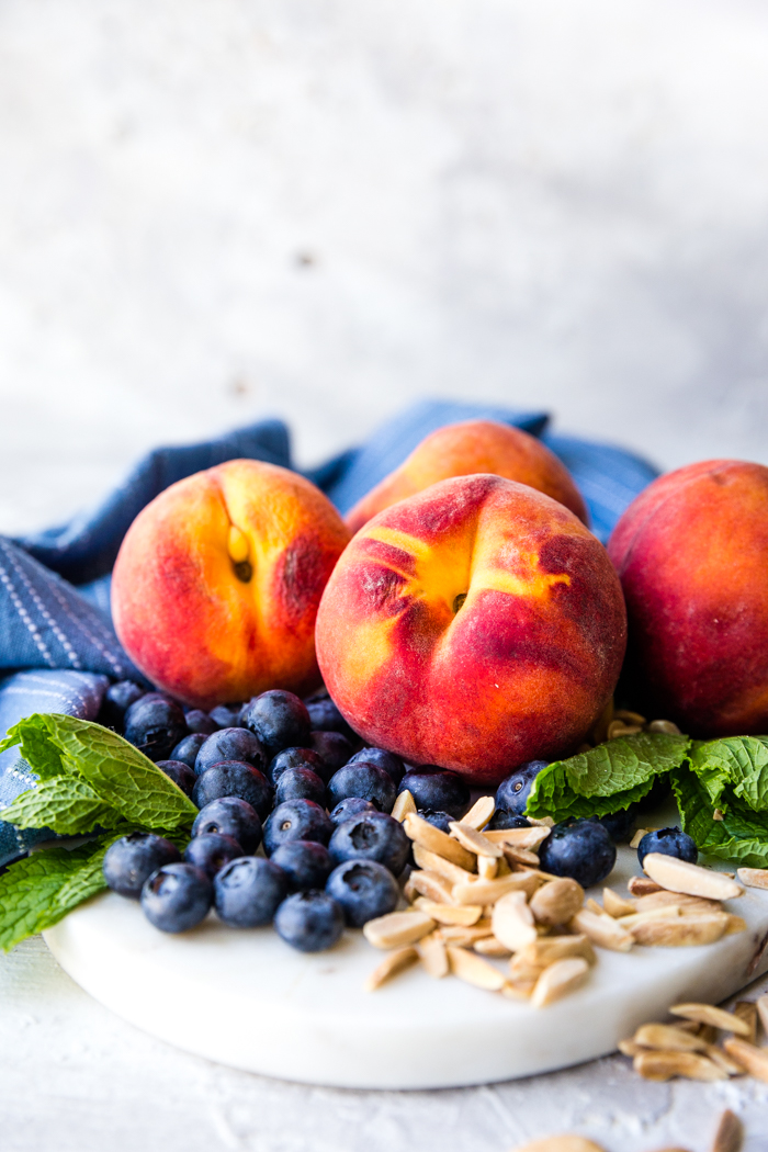 Peaches, blueberries and nuts on a plate
