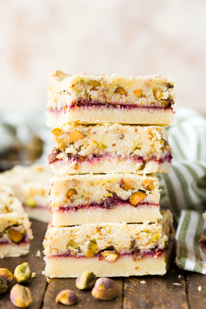 A stack of raspberry pistachio shortbread bars