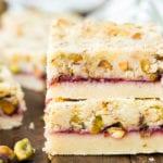 Two raspberry pistachio shortbread bars