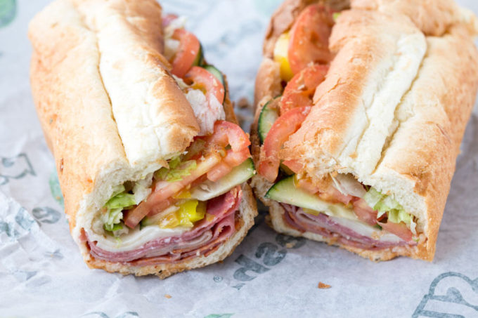 Italian hero Subway sandwich with layered meat and cheese