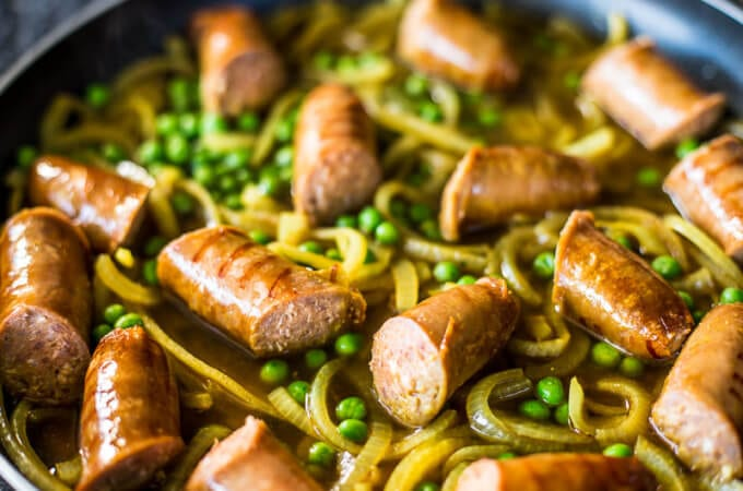 Best Curried Sausages Recipe - Creamy, easy deliciousness in a warming bowl ready to chow down with a side of fresh mash potato. Yes please! | wandercooks.com