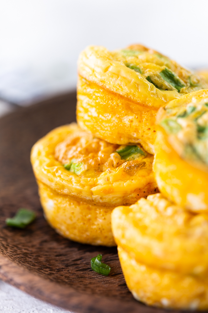 Close up of 4 buffalo chicken egg muffins on a brown plate