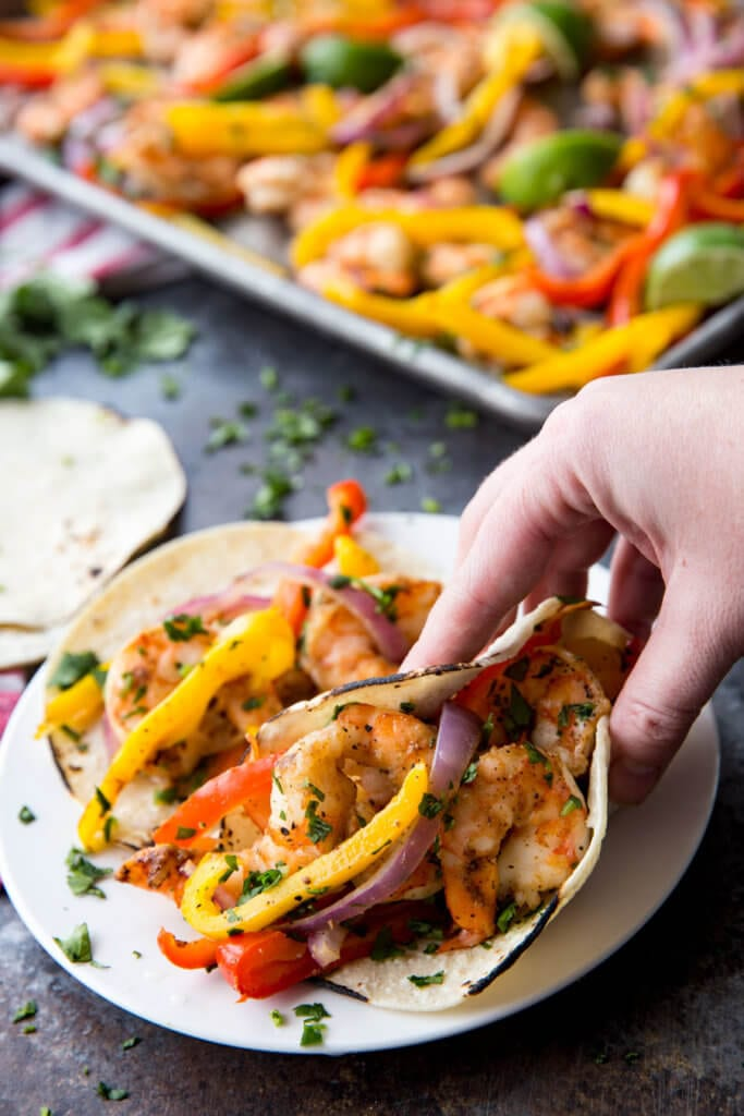 Eating flavorful shrimp fajitas