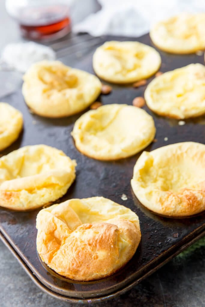 Puffy German Pancakes are an easy to make puff pancake in muffin tin size