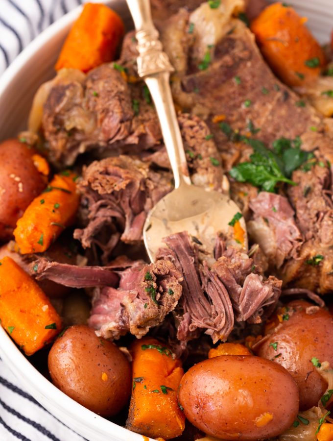 Instant Pot Pot Roast, fork tender, fall apart delicious with roasted carrots and potatoes