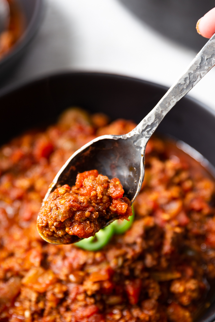 a bowl and spoonful of chili