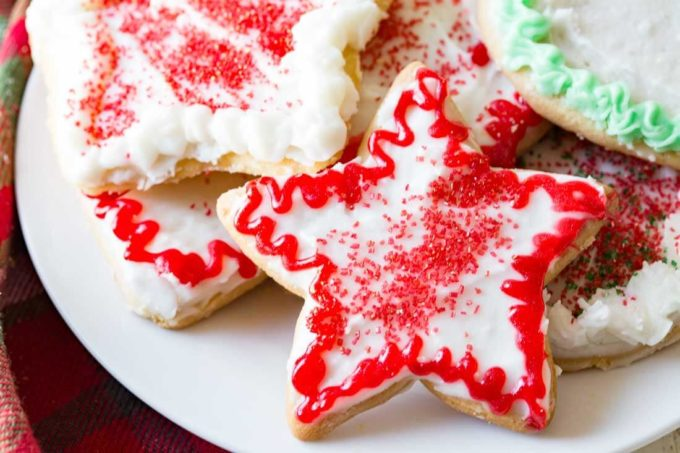 Christmas Sugar Cookies are crispy cut out sugar cookies iced and sprinkled.