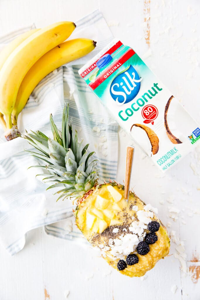 Pina Colada Smoothie Bowl. This coconut mango smoothie bowl offers a refreshing smoothie with a creamy undertone and tropical feel, bursting with mango, pineapple, and coconut flavor. Coconut milk, pineapple, mango, and coconut flakes make this a creamy, smooth, delicious breakfast or treat!