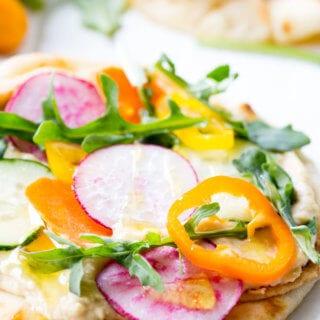 Vegetable Hummus Flatbread is loaded with fresh veggies and hummus