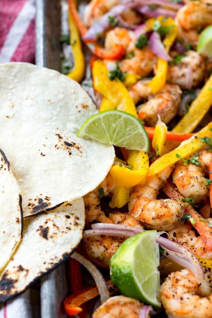Easy to make shrimp fajitas are a delicious sheet pan meal ready in 15 minutes