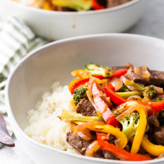 steak stir fry with most of the second bowl in background