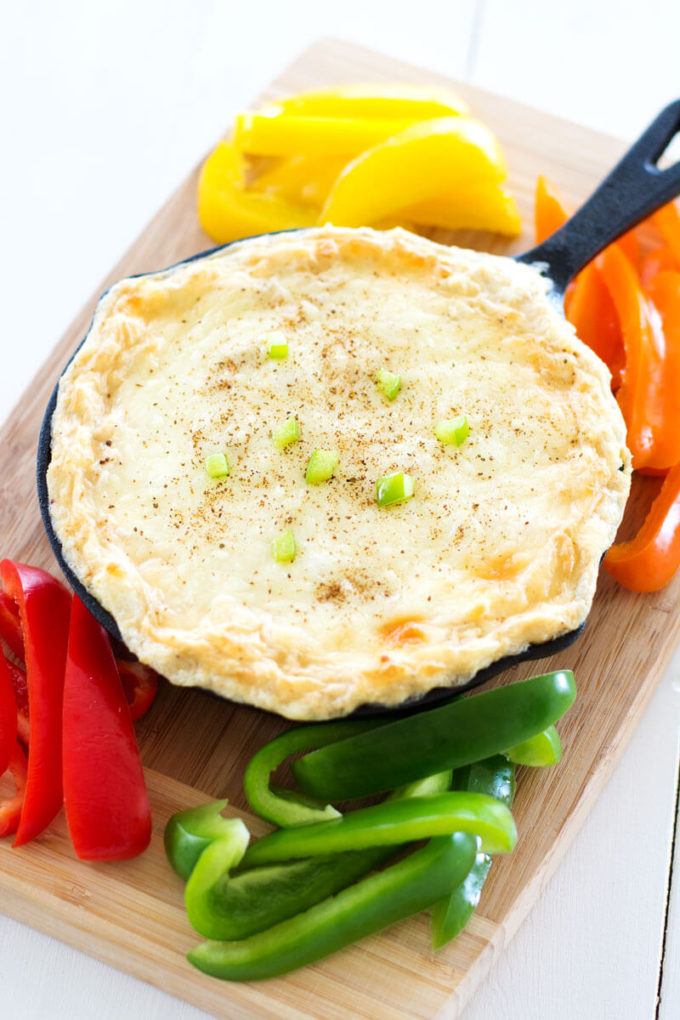 Your favorite pasta dish gets a makeover with this creamy Cajun Chicken Alfredo Dip with cream cheese, mozzarella, chicken and spice. Only five ingredients in this super cheesy dip with a creole kick!