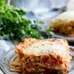 A traditional lasagna recipe full of meat, cheese, and mushrooms