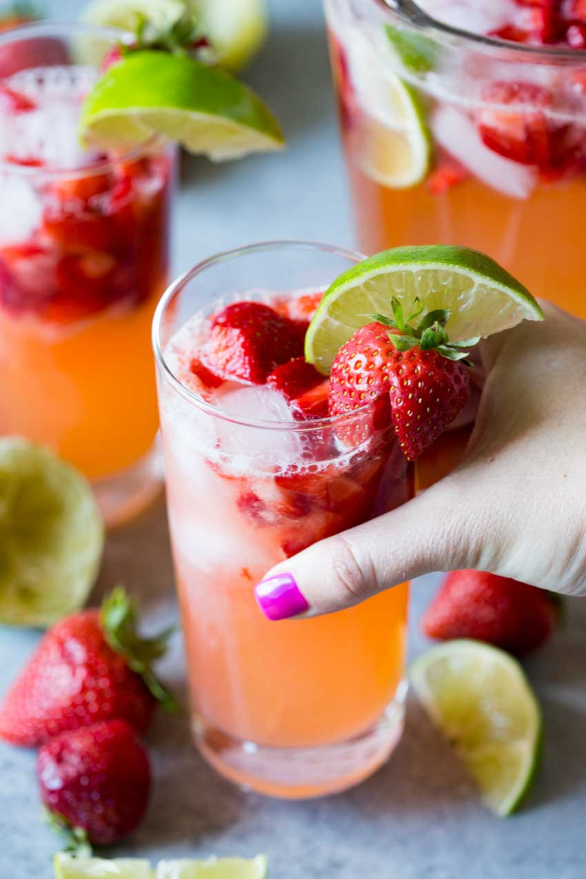 A glass of sparkling strawberry limeade.