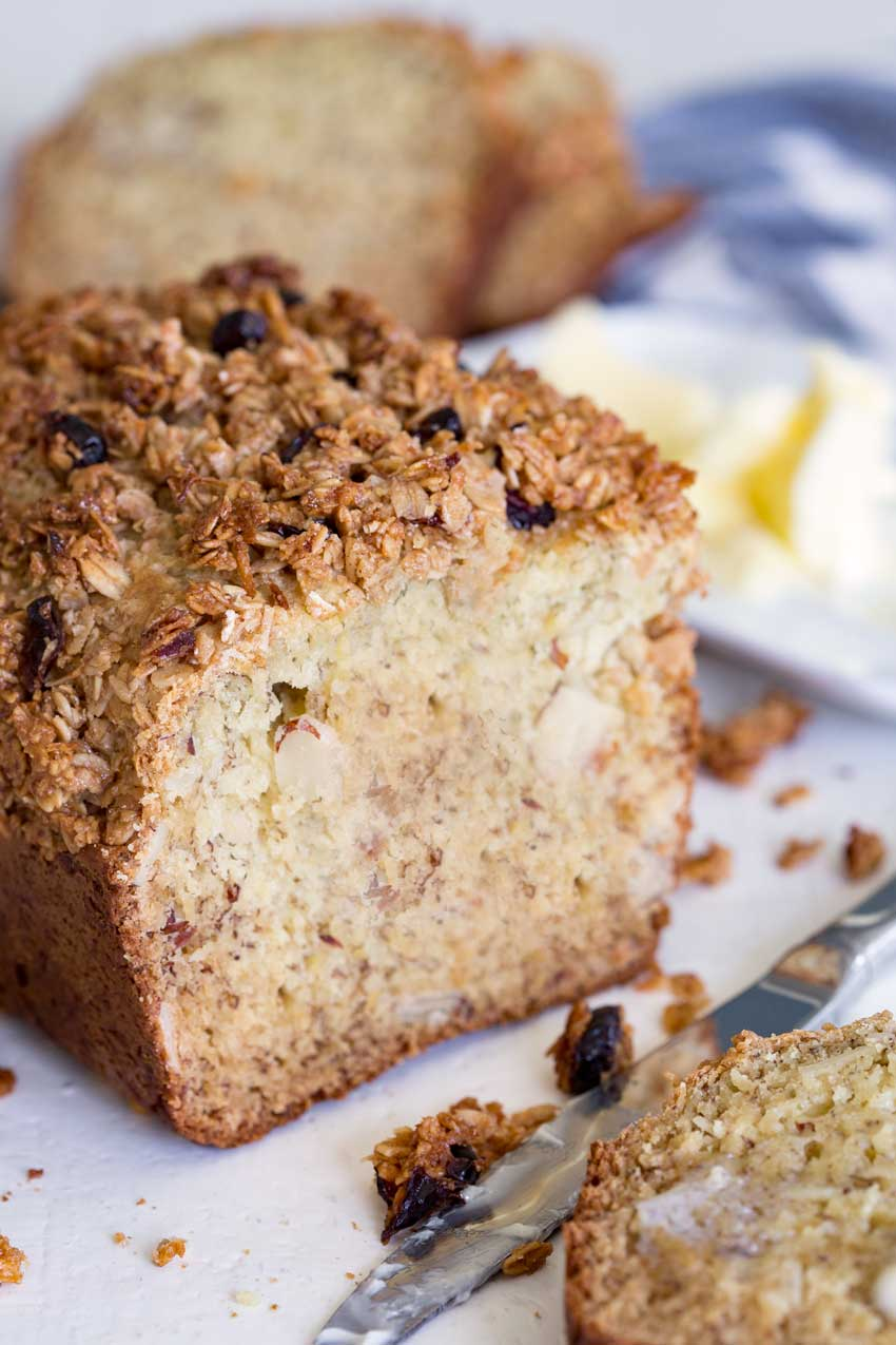 A loaf of cranberry almond granola topped banana bread