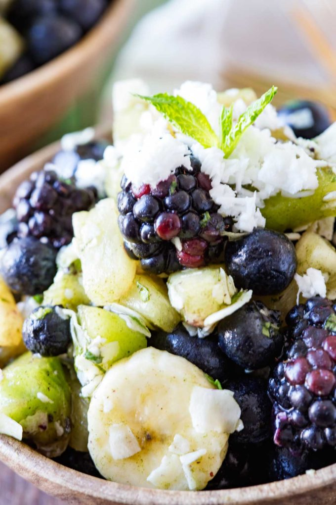 A pina colada fruit salad with beauty greens
