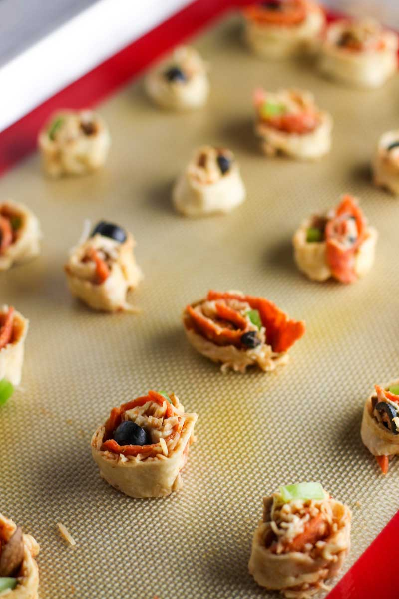 These Supreme Pizza Pinwheels are the perfect appetizer to please the whole crowd!