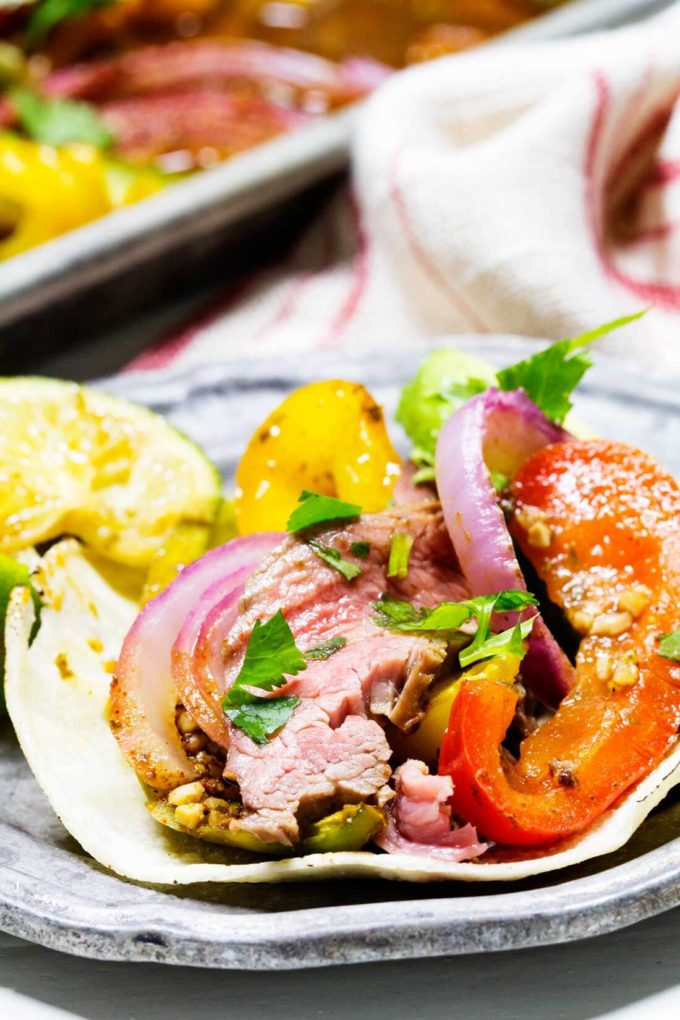 A delicious, tender, packed with flavor fajita flank steak cooked on a single sheetpan