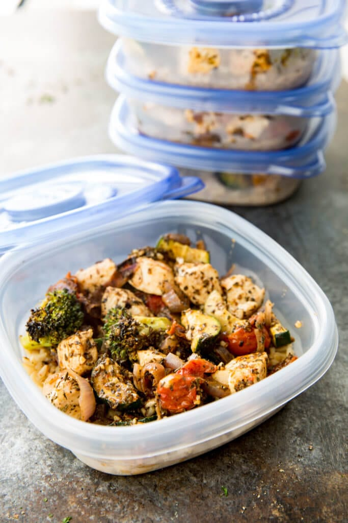 Chicken Meal Prep Ideas: Brown rice, zucchini, broccoli, tomatoes, onion and seasoned chicken, all cooked on a sheet pan for big flavor, meal prep!