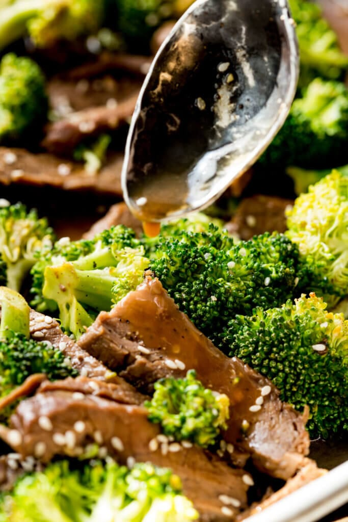 Spooning sauce over beef and broccoli