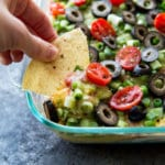 Classic 7 layer cheese dip with a twist. This upgraded 7 layer dip is amazing