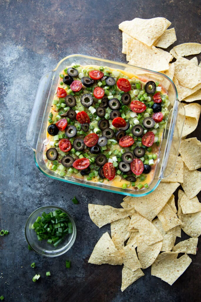 Classic 7 Layer dip just got an upgrade with pourable cheese