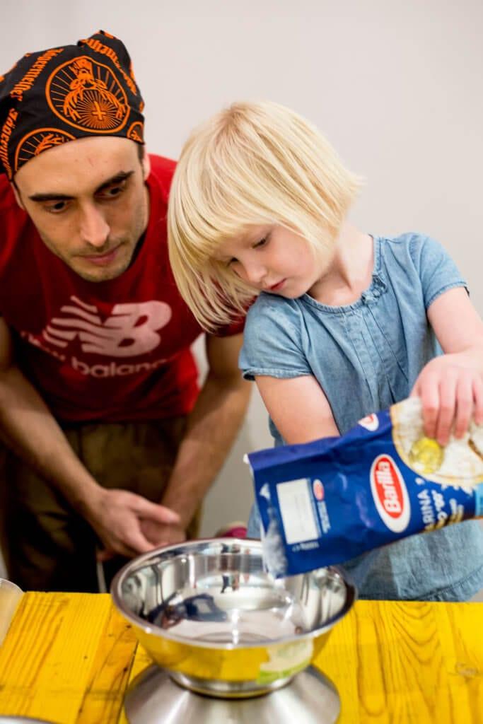 CC making PASTA in ROME measuring flour