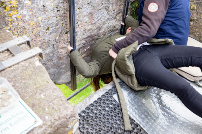 Kissing the Blarney Stone at Blarney Castle county cork Ireland